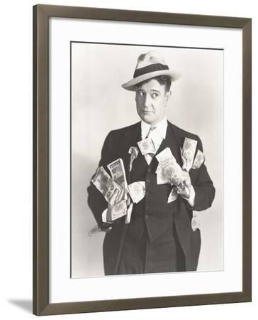 Man Holding Wads of Fake Money--Framed Photo