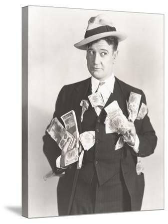 Man Holding Wads of Fake Money--Stretched Canvas Print