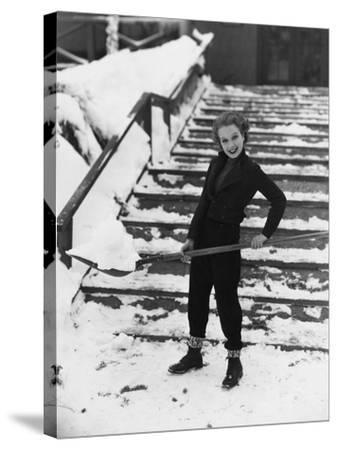 Portrait of Woman Shoveling Snow--Stretched Canvas Print