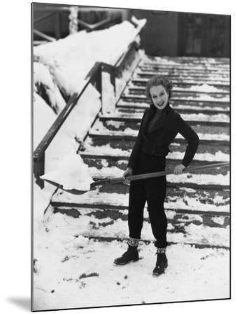 Portrait of Woman Shoveling Snow--Mounted Photo
