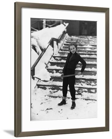 Portrait of Woman Shoveling Snow--Framed Photo