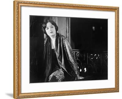 Portrait of Woman Sitting Near Window at Night--Framed Photo