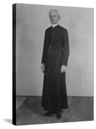 Priest in Cassock--Stretched Canvas Print
