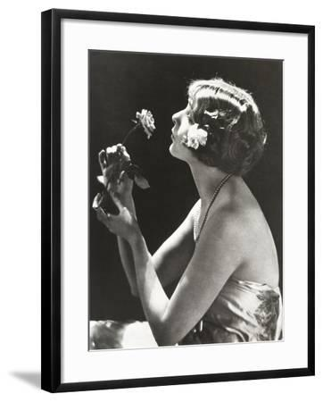 Profile View of Young Woman Smelling Flower--Framed Photo