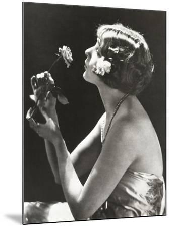 Profile View of Young Woman Smelling Flower--Mounted Photo
