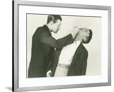 Punched in the Chin--Framed Photo