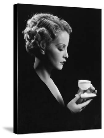 Portrait of Woman with Beverage--Stretched Canvas Print