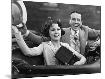 Portrait of Happy Couple Waving in Car--Mounted Photo