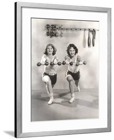 Two Women Exercising with Dumbbells at Gym--Framed Photo
