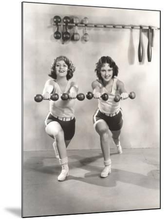Two Women Exercising with Dumbbells at Gym--Mounted Photo
