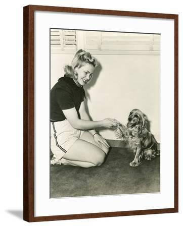 Shaking Hands with Her Cocker Spaniel--Framed Photo