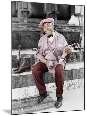 Shoeshine Man Working and Smiling--Mounted Photo