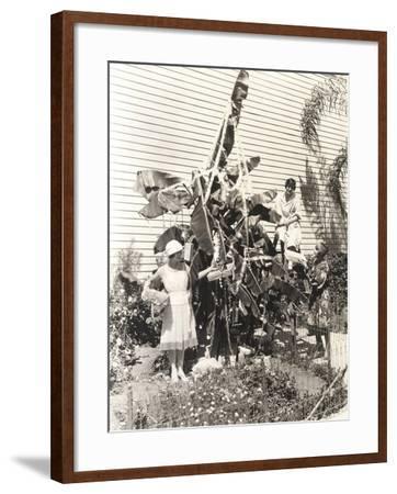 Three Women Decorating Banana Tree for Christmas--Framed Photo