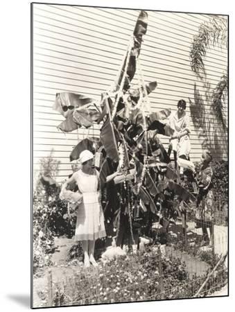 Three Women Decorating Banana Tree for Christmas--Mounted Photo