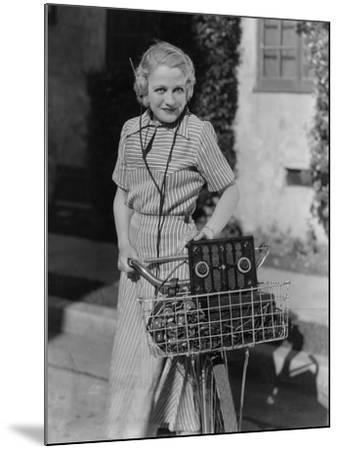 Woman with Bicycle and Radio--Mounted Photo