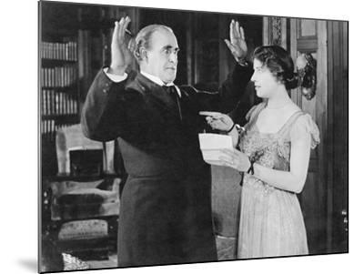 Woman with a Letter in Her Hand Pointing at a Man--Mounted Photo