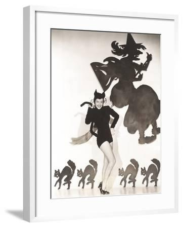 Woman in Cat Costume Posing Against Halloween Themed Wall--Framed Photo