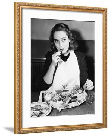 Young Woman with a Bib Eating Lobster--Framed Photo