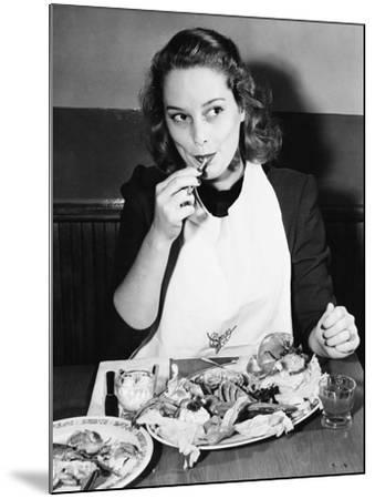 Young Woman with a Bib Eating Lobster--Mounted Photo