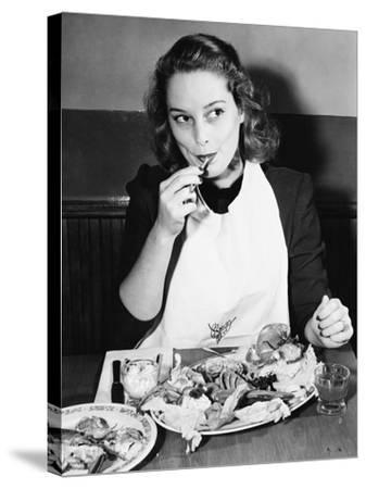 Young Woman with a Bib Eating Lobster--Stretched Canvas Print