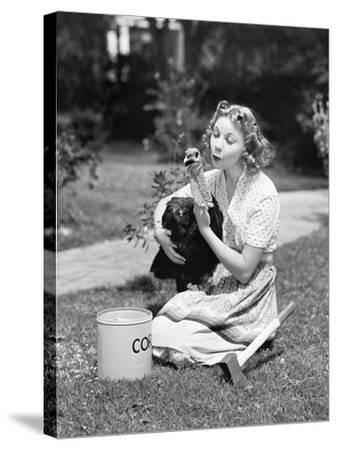 Young Woman, with an Ax Next to Her, Hugs a Turkey--Stretched Canvas Print