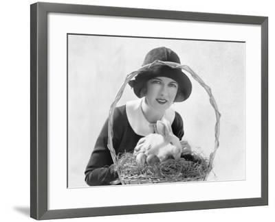 Young Woman with an Easter Basket and a Bunny--Framed Photo