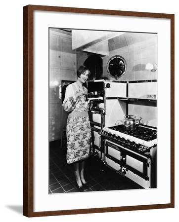 Woman with Large Stove--Framed Photo