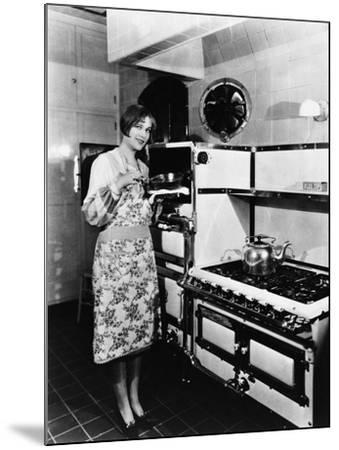 Woman with Large Stove--Mounted Photo