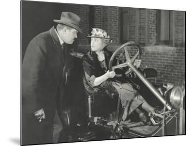 Woman Taking the Car for a Spin Against Husband's Wishes--Mounted Photo