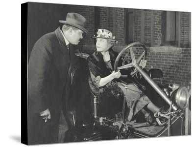 Woman Taking the Car for a Spin Against Husband's Wishes--Stretched Canvas Print
