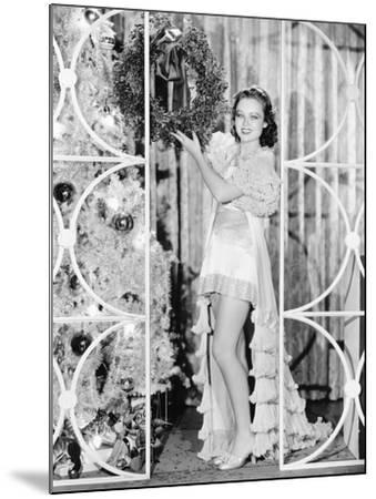 Woman in Lingerie Holding a Christmas Wreath--Mounted Photo