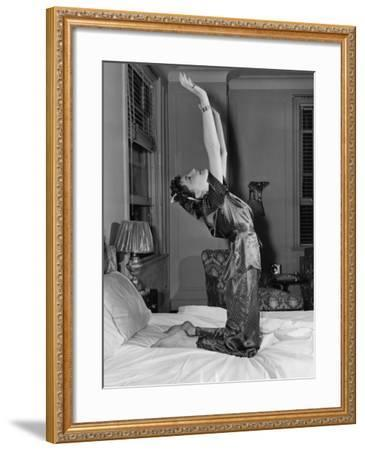 Woman Stretching on Bed--Framed Photo