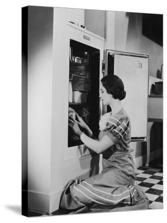 Woman with Refrigerator--Stretched Canvas Print