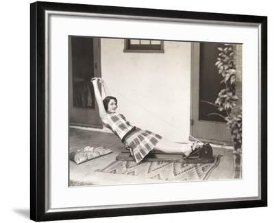 Woman Using Rowing Machine at Home--Framed Photo