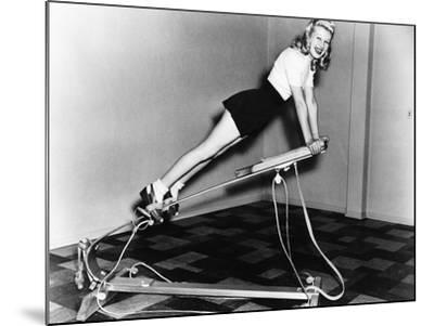 Woman Using Exercise Equipment--Mounted Photo