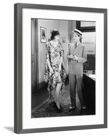 Woman Showing Her Legs to a Man--Framed Photo