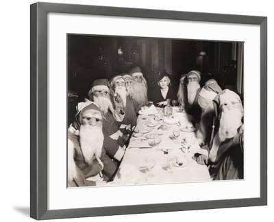 Woman Lunching with Twelve Santa Clauses--Framed Photo