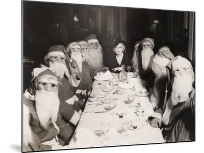 Woman Lunching with Twelve Santa Clauses--Mounted Photo