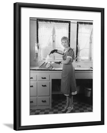 Woman Washing Dishes--Framed Photo