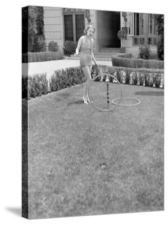 Young Woman in a Sun Suit Playing with Rings in the Yard--Stretched Canvas Print