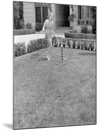 Young Woman in a Sun Suit Playing with Rings in the Yard--Mounted Photo