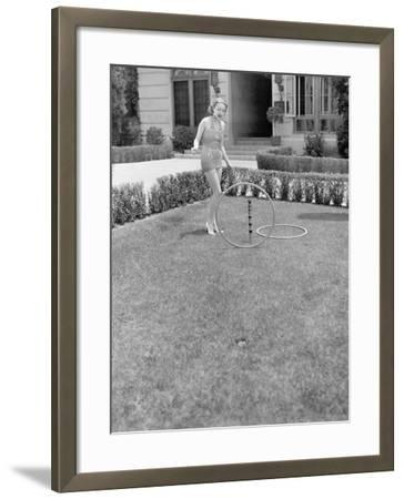 Young Woman in a Sun Suit Playing with Rings in the Yard--Framed Photo