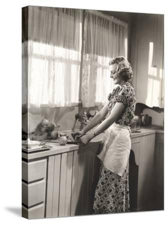 Woman Making Homemade Orange Juice--Stretched Canvas Print
