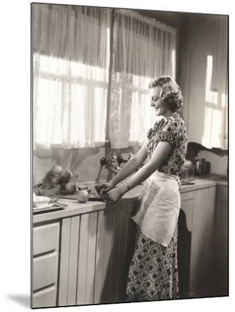 Woman Making Homemade Orange Juice--Mounted Photo