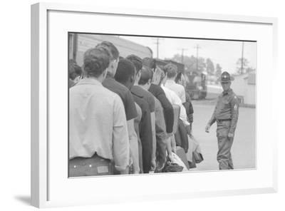 Young men who have been drafted wait in line to be processed into the US Army at Fort Jackson, SC-Warren K^ Leffler-Framed Photographic Print