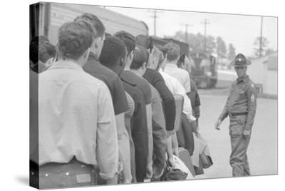 Young men who have been drafted wait in line to be processed into the US Army at Fort Jackson, SC-Warren K^ Leffler-Stretched Canvas Print