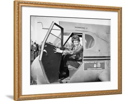 Amelia Earhart in an aeroplane, 1936-Harris & Ewing-Framed Photographic Print