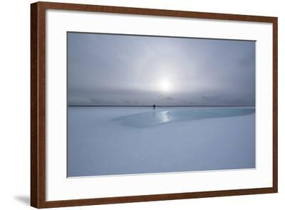 Lonely Person in Icelandic Lowlands with Blue Puddle of Water and Sun in the Background, Winter-Niki Haselwanter-Framed Photographic Print