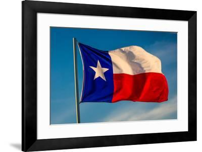 """TEXAS STATE FLAG - Texas """"Lone Star"""" flag stands out against a cloudless blue sky as it flys in...--Framed Photographic Print"""