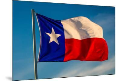 """TEXAS STATE FLAG - Texas """"Lone Star"""" flag stands out against a cloudless blue sky as it flys in...--Mounted Photographic Print"""